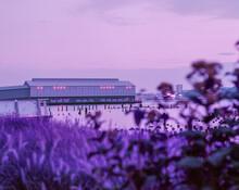 Surreal Purple Building On Boa...