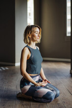 Pleased Woman During Meditation At Home