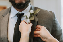 Boutonniere Being Pinned On Gr...
