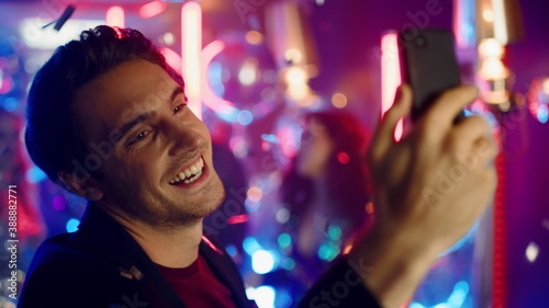 Fotografering Emotional man having video call at party