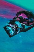 Shiny Gems Under Colorful Light