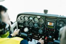 Pilots During Flight In Airplane