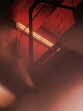 A Stairwell With A Red Light A...