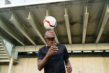 Black Sportsman Playing Footba...