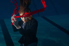 Woman With Red Ribbons Underwater