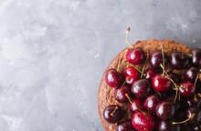 Chocolate Cake With Cherries On Gray Background. Cherries. Cherry. Fresh Cherries. Sweet Food Concept, Copyspace