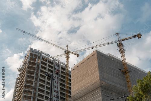 Crane at construction site Fototapet