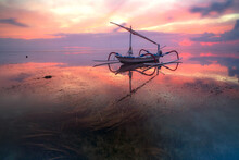 Landscape With A Fishing Boat In The Ocean At Low Tide At Dawn