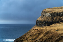 Shore Of Faroe Islands With Tiny Figures Of Four Women