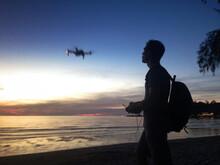 Drone Pilot Silhouette, Blurre...