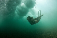 Girl Freediver Dives Under The...