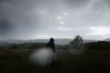 Rain Drops On The Camera As A Hooded Figure Walks In The Countryside