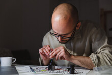 Artist Preparing Items To Job