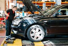 Male Mechanic Repairing Car Wh...