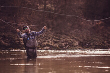 Fly Fisherman Throwing Fishing...