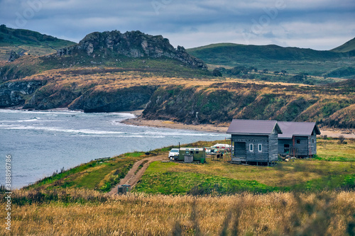 Scenic view of sea and landscape against cloudy sky, Krabbe Peninsula, Russia