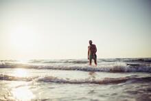 Senior Man Walking In Water At...