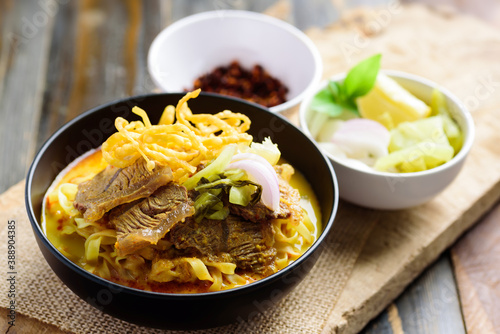 Fotomural Northern Thai food (Khao Soi), Spicy curry noodles soup with beef in a bowl eati