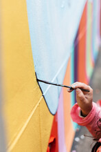 Artist Painting A Wall With A ...