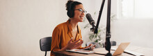 Female Podcaster Making Audio Podcast From Her Home Studio