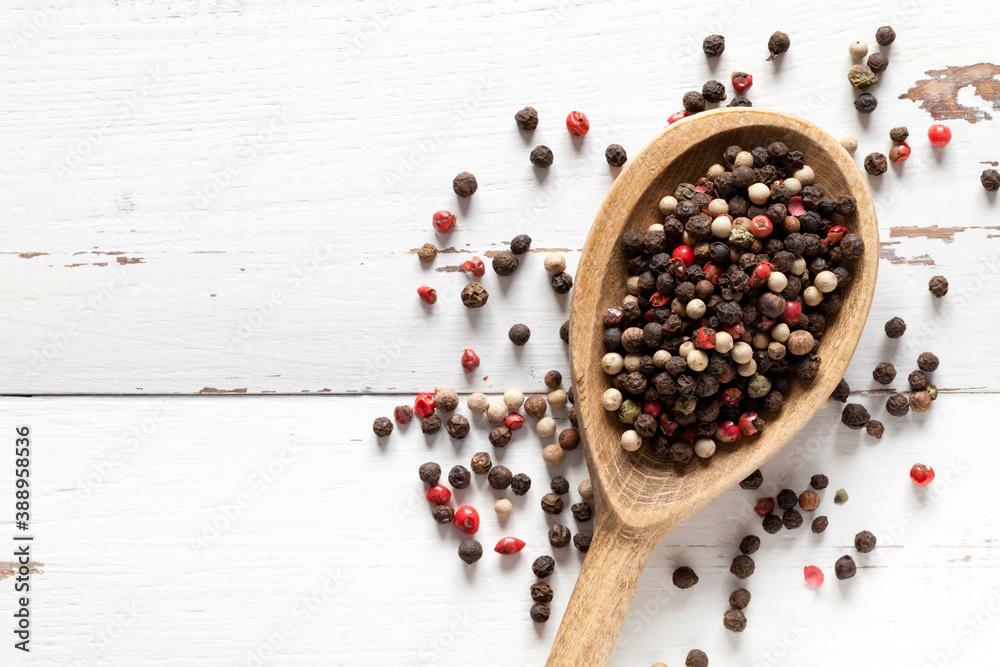 Fototapeta Close up of pepper on white wooden table