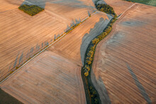 Abstract Aerial View Of Mowed Field With Winding Country Road In Oßmannstedt, Thüringen, Germany.