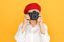 Creativity, Art And Modern Technology Concept. Horizontal Image Of Unrecognizable Female Photographer With Wrinkles Holding DSLR Camera At Her Face, Taking Pictures While Shooting In Studio