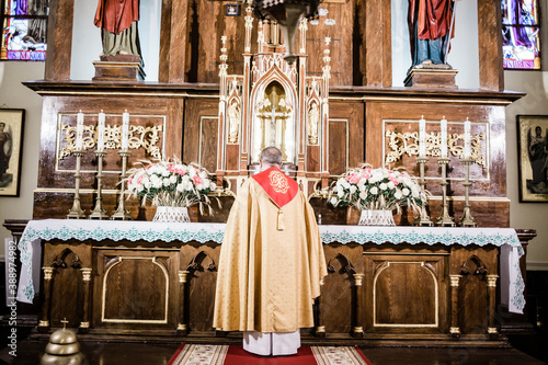 Cuadros en Lienzo a catalytic priest at the altar in the interior of the church