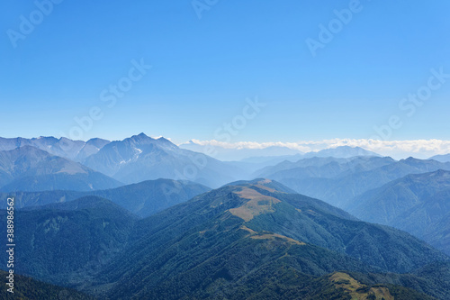 Fotomural view from the top of Mount Oshten to the ridges of the Caucasus Mountains in a b