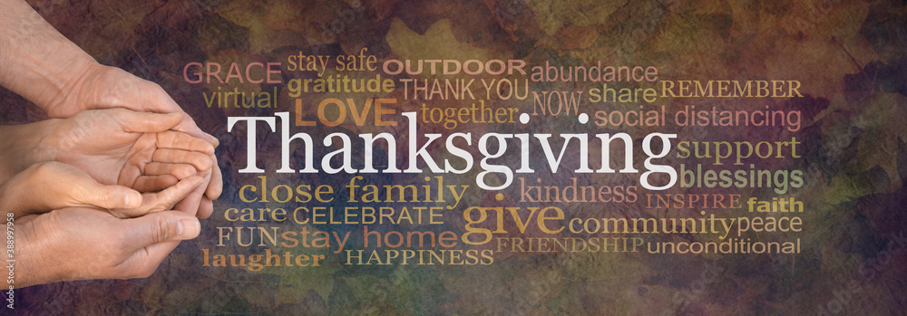 Fototapeta Togetherness and a Cosy Covid Thanksgiving Word Cloud banner - male hands cupped around female  hands beside a THANKSGIVING word cloud against a rustic grunge Autumnal leaf brown background
