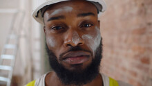 Close Up Portrait Of Tired Man Construction Worker With Dirty Face Looking At Camera