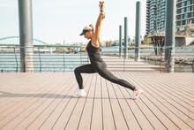 Woman In Sportswear Doing Exer...