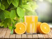 Orange Juice And Slices Of Ora...