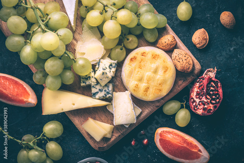 Cheese plate with fatty cheeses and fruits Canvas Print
