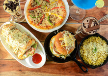 Assorted Foods Cheese Grilled Sandwich,paneer Cheese Burger,cheese Maggie And Capsicum Pizza On Wooden Background. Dishes And Appetizers Of Indian Cuisine