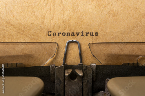 Fotografering The concept of combating coronavirus. Typewriter text.