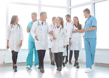 Young Medical Doctors Striding...