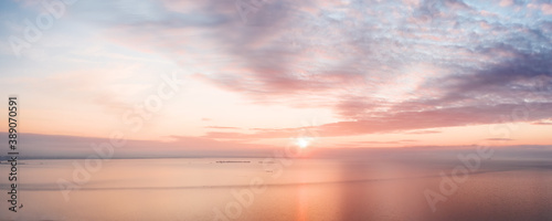 Obraz Calm pink colored sea and sky at sunset - fototapety do salonu
