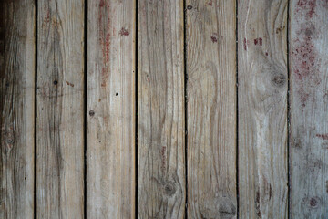 Old board in erased paint. Wooden wall of an old building. Background for design.