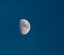 Half Moon On Blue Sky