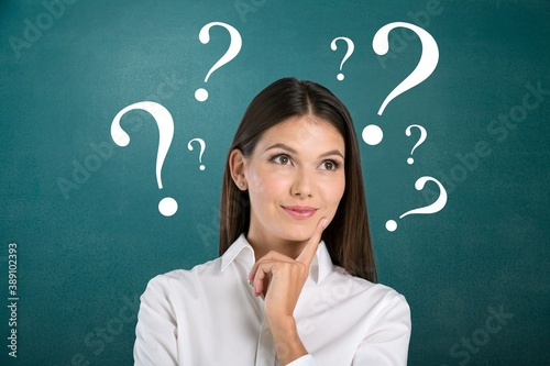 Question sign with a beautiful alarmed woman on pastel background Wallpaper Mural