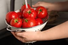 Woman Washing Ripe Tomatoes In...