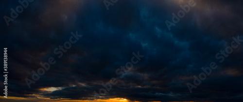 Dark orange sky, sunset, panorama. Storm clouds. Fotobehang