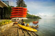 A Stack Of Orange Rental Canoe...