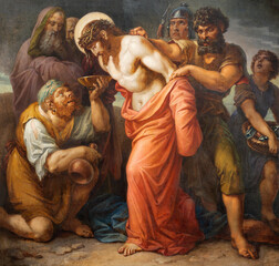 Fototapeta Dla Kościoła VIENNA, AUSTIRA - OCTOBER 22, 2020: The painting Jesus clothes are taken away in church St. Johann der Evangelist by Karl Geiger (1876).