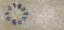 Abalone Shell Circle Website Banner Background - Polished Slices Of Abalone Shell Neatly Arranged In A Circle Border Against Handmade Fibrous Beige Paper With Copy Space On Right