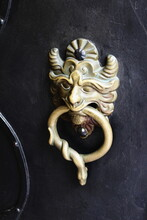 Detail Of A Door With A Knocker At The Birthplace Of Wolfgang Amadeus Mozart In Salzburg, Austria.