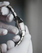 Hands In White Gloves Show The Polish On The Stainless Steel Watch Case