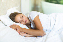 Portrait Of Beautiful Young Woman Sleeping In The Bed.