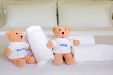 White Towel With Teddy Bear On...